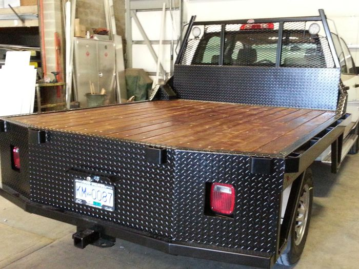 Passenger side of wood flat deck w blk pc checkerplate